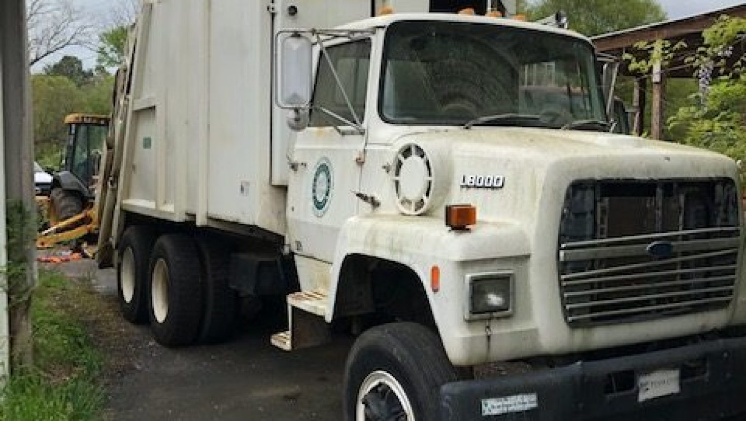 We are selling an older used garbage truck  Copy