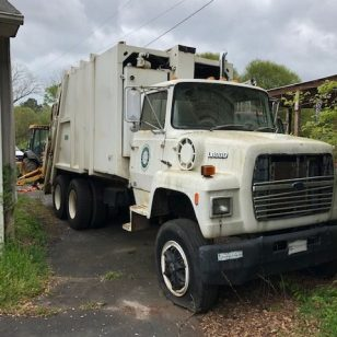 We are selling an older used garbage truck